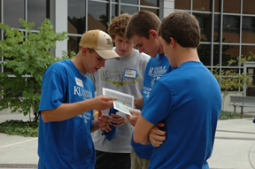 [A Frosh Frenzy team consults before taking off on their trek]